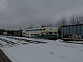 SunRail Bombardier BiLevel Coach on a CP freight train.jpg