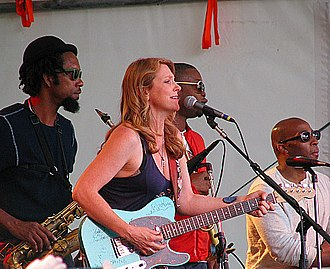 Susan Tedeschi - Susan Tedeschi and The Tedeschi Trucks Band at the Appel Farm Arts and Music Festival, June 2012. Kebbi Williams on saxophone, Maurice Brown on trumpet, and Saunders Sermons on trombone are in the background (left to right)
