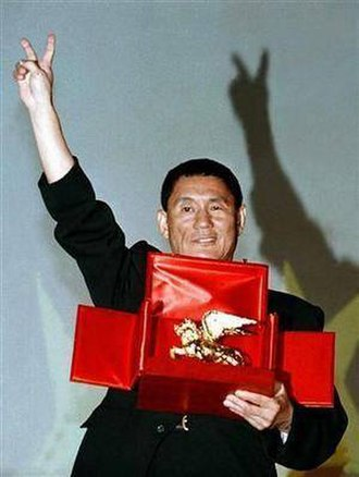 Takeshi Kitano - Kitano accepting the Golden Lion Award in 1997 for his film Hana-bi.