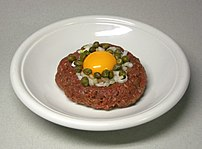 Steak tartare with egg, capers and onions