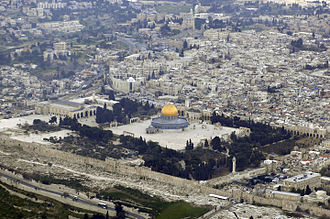 View of Temple Mount, also known as the Aqsa Mosque, looking southwest, with the golden Dome of the Rock visible center and the Qibli Chapel to the left beyond some trees, both are part of the Aqsa Mosque. Parts of the Old City of Jerusalem can be seen surrounding the Mount. Temple Mount (Aerial view, 2007) 03.jpg
