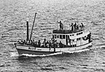 Thai fishing boat with the crew of the seized SS Mayaguez underway on 15 May 1975.jpg