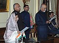 The President, Smt. Pratibha Devisingh Patil administrating the oath of office to the Chief Information Commissioner, Shri Satyananda Mishra, at a Swearing-in Ceremony, in Rashtrapati Bhavan, New Delhi on December 20, 2010.jpg
