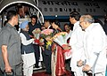 The Prime Minister, Dr. Manmohan Singh being received by the Governor of the Andhra Pradesh, Shri E.S.L. Narasimhan, at Begumpet Airport, in Hyderabad on February 05, 2011.jpg