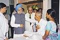 The Prime Minister, Dr. Manmohan Singh consoles an injured person at Lokmanya Tilak Hospital in Mumbai on July 14, 2006.jpg