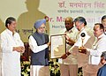 The Prime Minister Dr. Manmohan Singh presenting the Krishi Karman award to the Chief Minister of Chhattisgarh, Dr. Raman Singh, at the 83rd ICAR Foundation Day function.jpg