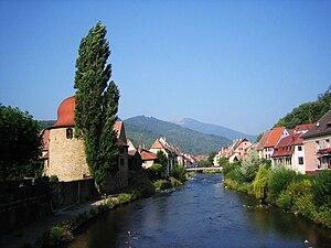 Thann, Haut-Rhin - La Tour des Sorcières (left) and the River Thur