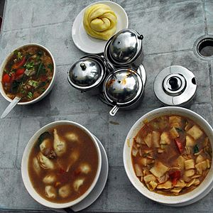 Tingmo - Clockwise from top: tingmo steamed bread, thenthuk noodle soup, momos in soup and vegetable gravy, with condiments in center from the Himalaya Restaurant, McLeod Ganj, Himachal Pradesh, India