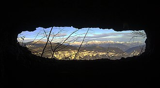 "Valstagna - View of the Dolomites from a World War I cave along the ""Vu"" trekking path."