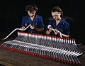 Two women workers are shown capping and inspecting tubing which goes into the manufacture of the Vengeance (A-31) dive bomber made at Vultee's Nashville division, Tennessee.jpg