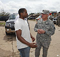 U.S. Army 1st Lt. Roderick Jones, left, with the 1345th Transportation Company, Oklahoma Army National Guard, tells Army Maj. Gen. Myles Deering, the adjutant general of Oklahoma, about his house being destroyed 130525-Z-VF620-4055.jpg