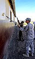 U.S. Army Pfc. Phillip Shin, right, with the 61st Multifunctional Medical Battalion, and South African National Defense Force Pvt. Dumakude Sibonelo paint the Masincedane Training Center during Shared Accord 130726-A-ZZ999-022.jpg