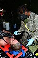 U.S. Army Spc. Ke'andrea Gouding, a chemical, biological, radiological and nuclear specialist with the 44th Chemical Company, 2nd Chemical Battalion, washes a notional survivor in a massive casualty 120729-A-IA524-879.jpg