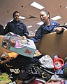 U.S. Navy Logistics Specialist donates items.jpg