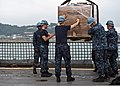 U.S. Sailors guide cargo onto the flight deck of the amphibious dock landing ship USS Tortuga (LSD 46) May 11, 2013, at White Beach in Okinawa, Japan 130511-N-IY633-225.jpg