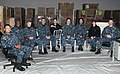 U.S. Sailors with the Coalition of Sailors Against Destructive Decisions assigned to the aircraft carrier USS Abraham Lincoln (CVN 72) pose for a photo while selecting chairs for the refitting of the ship 131211-N-EB301-077.jpg