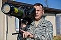 USAF Col. Cloyce Adams holds a man-portable aircraft survivability trainer.jpg