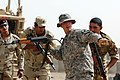 US Army 51820 BAGHDAD - Spc. Adam Lowe (center), from Oklahoma City, Okla., with D Troop, Division Special Troops Battalion, 1st Cavalry Division, gives pointers about room clearing to Soldiers of the 6th Iraqi Arm.jpg