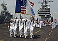 US Navy 020620-N-6747H-001 Sailors prepare to display the 50 state flags.jpg