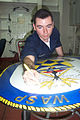 US Navy 020825-N-2210L-001 Artistic Sailor uses talents to finish Wasp's logo.jpg
