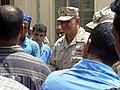 US Navy 030424-M-8658H-007 Rear Adm. Charles Kubik, Commander, First Naval Construction Division, speaks to the citizens of Umm Qasr about the newly renovated Umm Qasr High School.jpg