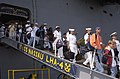 US Navy 030529-N-1522S-008 Sailors and family members depart the amphibious assault ship USS Nassau (LHA 4).jpg