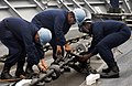 US Navy 040513-N-2101W-009 Deck Department Sailors aboard the guided missile cruiser USS Cowpens (CG 63) remove the chain stoppers.jpg