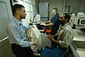 US Navy 040814-N-4190W-010 Aviation Structural Mechanic Airman Moataz Ghonem, an Egyptian-American assigned to Helicopter Anti-Submarine Squadron Fifteen (HS-15) helps translate for Iranian mariners.jpg