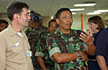 US Navy 050210-N-6504N-007 Commander of the Indonesian government disaster relief operation in Banda Aceh, Maj. Gen. Bambang Darmono, talks to a doctor that works in the operating room aboard the Military Sealift Command (MSC).jpg
