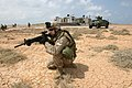 US Navy 050426-M-9750B-081 Cpl. Joseph M. Abasciano assigned to Echo Company, Battalion Landing Team, 2nd Bn., 8th Marines secures the perimeter at a beach in Djibouti.jpg
