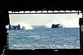 US Navy 050726-N-4772B-018 A pair of Landing Craft, Air Cushions (LCAC) make their way to the well deck of the amphibious dock landing ship USS Harpers Ferry (LSD 49).jpg
