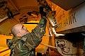 US Navy 060110-N-3488C-001 Aviation Machinist Mate 3rd Class Christopher Creek cleans a engine bay door on an F-A-18F Super Hornet.jpg