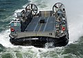 US Navy 070521-N-8923M-194 A landing craft air cushion (LCAC) approaches the aft end of amphibious assault ship USS Wasp (LHD 1).jpg