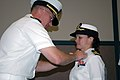 US Navy 070714-N-8102J-007 Cmdr. Kelly Nielsen receives the Bronze Star Medal from Cmdr. Joseph Sweeney, commanding officer of Naval Air Systems Command 0466 Det. A.jpg