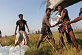US Navy 071127-N-5642P-154 Local residents assist in unloading bags of fresh water from a CH-53E Sea Stallion helicopter attached to Marine Medium Helicopter Squadron (HMM) 261.jpg