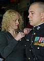 US Navy 071215-N-9271M-003 Marine Corps Reserve Officer Training Corps Cadet Christopher A. Cichy, becomes 2nd Lt. Cichy as his wife pins his officer insignia to his uniform at a joint commissioning ceremony.jpg