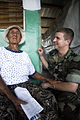 US Navy 080814-N-9620B-017 A Nicaraguan woman talks to Hospital Corpsman Mathew Coleman at Llano Verde School during a Continuing Promise 2008 medical humanitarian assistance project.jpg
