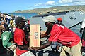 US Navy 080922-N-7955L-118 Haitian civilians help move boxes of cooking oil delivered by U.S. service members embarked aboard the amphibious assault ship USS Kearsarge (LHD 3) during a humanitarian assistance mission.jpg