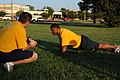 US Navy 080926-N-0000Y-001 Personnel Specialist 1st Class Brandon Norman performs pushups as Chief Yeoman James Hurm keeps count during a Navy Personnel Command mock physical fitness assessment.jpg