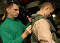 US Navy 081028-N-2456S-158 Aircrew Survival Equipmentman 2nd Class James Wilson assists Aviation Warfare Systems Operator 2nd Class Ian Hamlet, both assigned to the.jpg