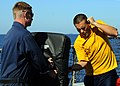 US Navy 090226-N-1082Z-025 Electronics Technician 3rd Class Kenny W. Rugg uses a baton to defend himself from Aviation Electrician's Mate 2nd Class Michael Piechowski after being sprayed with Oleoresin Capsicum (OC).jpg