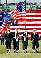 US Navy 090407-N-1963G-071 Members of the USS Constitution color guard parade the national ensign during the Boston Red Sox opening day baseball game at Fenway Park.jpg