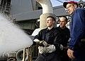 US Navy 090914-N-5345W-263 Chief Damage Controlman Donald Grothe supervises Hull Maintenance Technician 3rd Class John South and Damage Controlman Fireman David Pritchard during a hose-handling training exercise.jpg