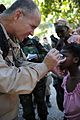 US Navy 100130-N-9375C-061 Dr. Mark Baker, M.D, from the University of Alabama at Birmingham examines a child in the Delmars 53 Section of Port-au-Prince, Haiti.jpg