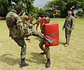US Navy 100511-N-9643W-141 Members of the Jamaica Defense Force practice hand-to-hand and close quarters combat techniques with Marines embarked aboard Swift (HSV 2).jpg