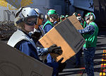 US Navy 101109-N-8744H-176 Sailors aboard the aircraft carrier USS Ronald Reagan (CVN 76) take boxes of supplies off a C-2A Greyhound from Fleet Lo.jpg