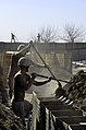 US Navy 101218-N-6436W-113 Active duty and reserve component Seabees assigned to Naval Mobile Construction Battalions 40, 18 and 26 secure and fort.jpg