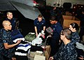 US Navy 110318-N-SG869-154 Sailors aboard the aircraft carrier USS Ronald Reagan (CVN 76) organize clothing donated by the crew.jpg