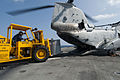 US Navy 110414-N-RC734-043 Boatswain's Mate 3rd Class Zachary Boylston moves cargo with a forklift to load onto a CH-46E Sea Knight helicopter.jpg