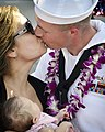 US Navy 110629-N-RI884-039 Interior Communications Electrician 2nd Class Debaun is greeted by his family at Joint Base Pearl Harbor-Hickam after re.jpg